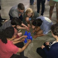 Blackburn Students participate in a team-building activity at the 2016 New Student Retreat
