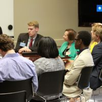 Students, Fellows, and Advisory Board members engaged in a community conversation