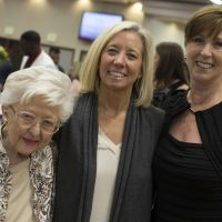Gloria Blackburn (Blackburn Society and Wife of Dr. Blackburn) and Holly Piper (Advisory Board and Daughter of Dr. Blackburn) join to congratulate Cheree Causey on her induction into the Blackburn Society